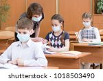school children with protection ... | Shutterstock . vector #1018503490