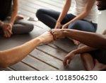 african and caucasian men fist...   Shutterstock . vector #1018506250