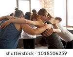 young diverse people embracing... | Shutterstock . vector #1018506259