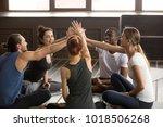 diverse happy yogi people reach ... | Shutterstock . vector #1018506268