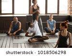 fitness instructor helping... | Shutterstock . vector #1018506298