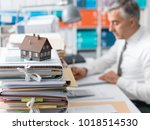 real estate agent working in... | Shutterstock . vector #1018514530