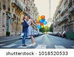 romantic couple on the street... | Shutterstock . vector #1018520533