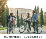 three young friends tourists... | Shutterstock . vector #1018535584