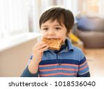 Little Eating Toast Bread With...