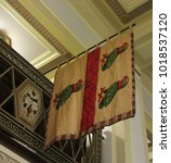 Small photo of London / UK - 01/29/18: Flag showing three popinjays divided by a fess of gules in museum of Freemasons' Hall on Great Queen Street.