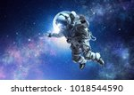 astronaut on space mission | Shutterstock . vector #1018544590