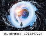 space hole and astronaut. mixed ... | Shutterstock . vector #1018547224