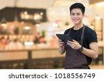 close up asian man barista... | Shutterstock . vector #1018556749