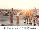 group of young people having... | Shutterstock . vector #1018557676