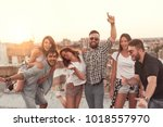 group of young people having... | Shutterstock . vector #1018557970