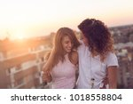 lesbian couple standing and... | Shutterstock . vector #1018558804