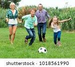 summer activity   smiling... | Shutterstock . vector #1018561990