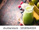 close up of green fresh... | Shutterstock . vector #1018564324