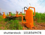 oil pipes and valves | Shutterstock . vector #1018569478