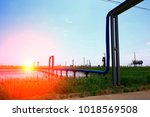 oil pipes and valves | Shutterstock . vector #1018569508