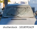 dirty car window with drawn... | Shutterstock . vector #1018592629