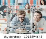 male and female engineering... | Shutterstock . vector #1018594648