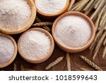 wooden bowls with different... | Shutterstock . vector #1018599643