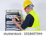 electrician at work with cables | Shutterstock . vector #1018607344