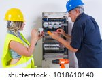 electricians at work with cables | Shutterstock . vector #1018610140