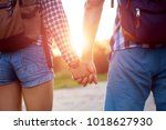 hiker young woman holding man's ... | Shutterstock . vector #1018627930