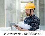 male engineer at a construction ... | Shutterstock . vector #1018633468