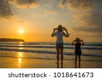 mother and daughter playing at... | Shutterstock . vector #1018641673