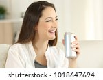 portrait of a woman holding a... | Shutterstock . vector #1018647694