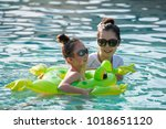 mother and daughter playing in... | Shutterstock . vector #1018651120