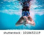 boy in mask dive in swimming... | Shutterstock . vector #1018652119