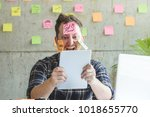 stressed man with message on... | Shutterstock . vector #1018655770