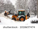 tractor clears the road from... | Shutterstock . vector #1018657474