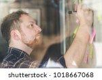 creative businessman writing... | Shutterstock . vector #1018667068