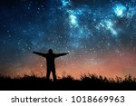 man watching the stars in night ... | Shutterstock . vector #1018669963