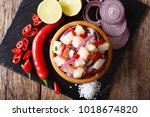 healthy fish ceviche of cod... | Shutterstock . vector #1018674820
