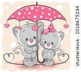 two cute cartoon kittens with... | Shutterstock .eps vector #1018675234