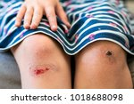close up of little girl holding ... | Shutterstock . vector #1018688098