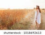 the pregant girl walking along...   Shutterstock . vector #1018692613