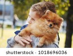 funny little boy playing with... | Shutterstock . vector #1018696036