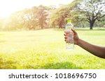 hand holding drinking water...   Shutterstock . vector #1018696750
