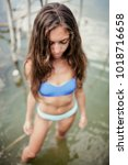 sexy girl in bikini posing in... | Shutterstock . vector #1018716658