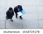 business colleagues standing... | Shutterstock . vector #1018725178
