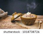 hot buckwheat porridge with... | Shutterstock . vector #1018738726