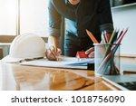 engineer man working with... | Shutterstock . vector #1018756090