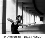 young girl dances in a black t... | Shutterstock . vector #1018776520