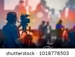 video camera operator working... | Shutterstock . vector #1018778503