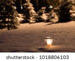 candle in the snow garden | Shutterstock . vector #1018806103