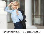 beautiful young stylish woman...   Shutterstock . vector #1018809250
