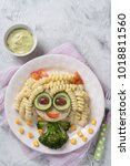 funny girl food face with... | Shutterstock . vector #1018811560